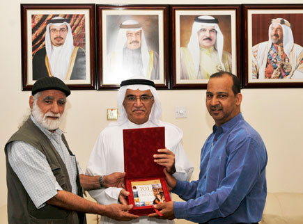 Mohammed Saleh Al haikh receive a copy of 101 Things to see and Do in Oman from Ali and Haider