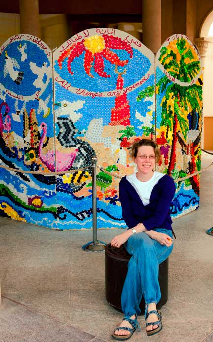 Sarah with the artwork created from bottle caps