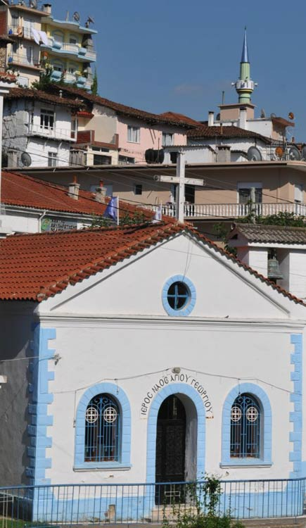A church and mosque exist close to each other in Krios