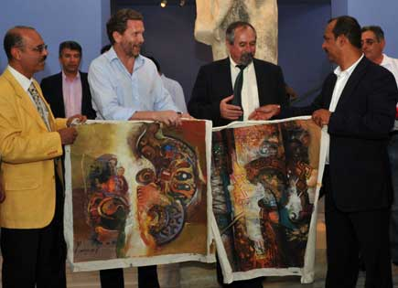 Almosawi presenting Mr Pavlos two of his paintings