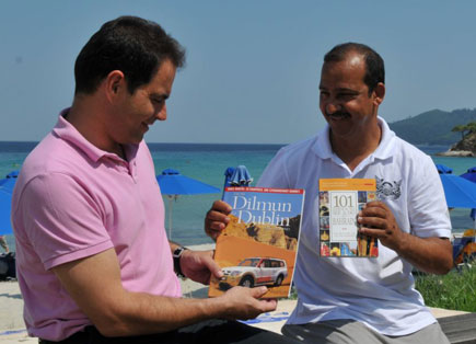 Ali shows Antonis some of the books he has produced