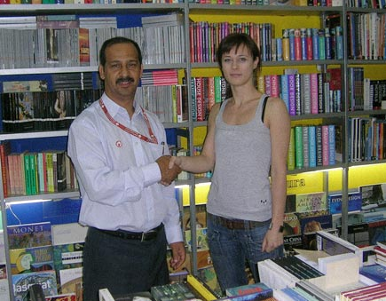 Ali with the manager of the bookstore